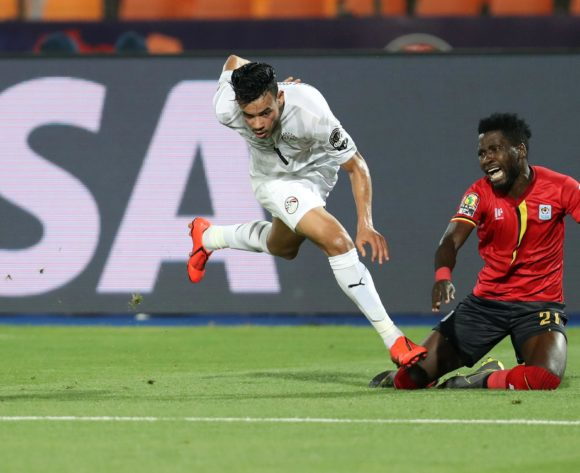 Allan Kyambadde of Uganda challenged by Trezeguet of Egypt during the 2019 Africa Cup of Nations Finals Uganda and Egypt at Cairo International Stadium, Cairo, Egypt on 30 June 2019 ©Samuel Shivambu/BackpagePix