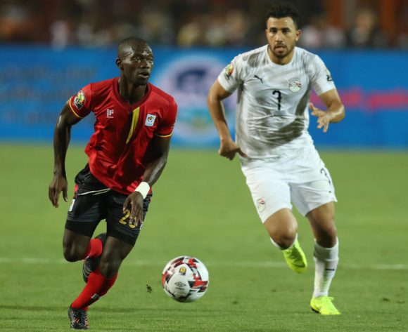 Michael Azira of Uganda challenged by Trezeguet of Egypt during the 2019 Africa Cup of Nations Finals Uganda and Egypt at Cairo International Stadium, Cairo, Egypt on 30 June 2019 ©Samuel Shivambu/BackpagePix