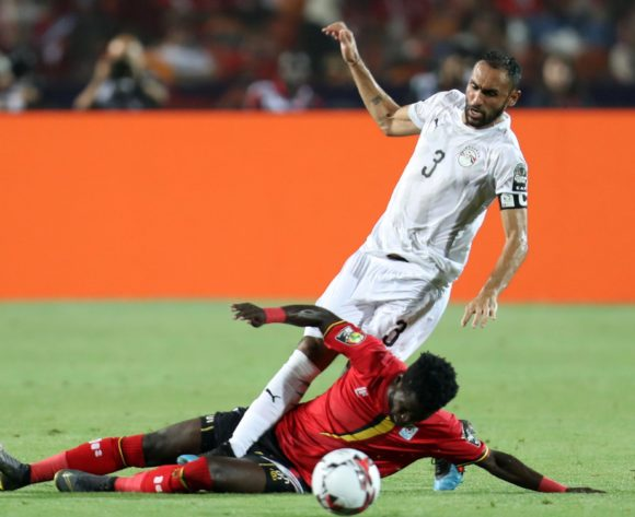 Ahmed El Mohamady of Egypt tackled by Allan Kyambadde of Uganda during the 2019 Africa Cup of Nations Finals Uganda and Egypt at Cairo International Stadium, Cairo, Egypt on 30 June 2019 ©Samuel Shivambu/BackpagePix