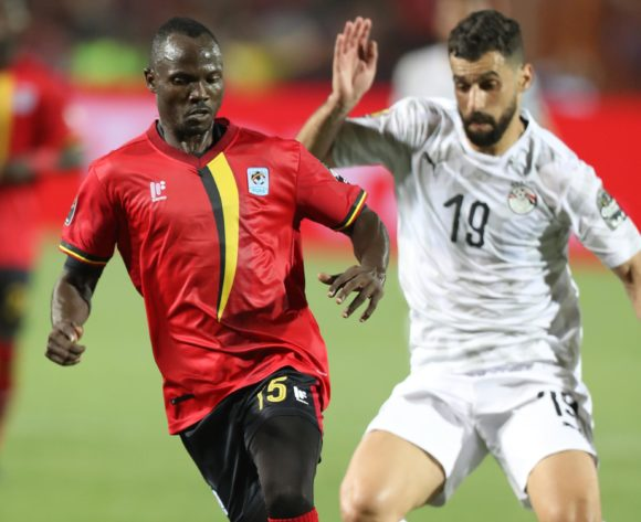 Godfrey Walusimbi of Uganda challenged by Ayman Ashram of Egypt during the 2019 Africa Cup of Nations Finals Uganda and Egypt at Cairo International Stadium, Cairo, Egypt on 30 June 2019 ©Samuel Shivambu/BackpagePix