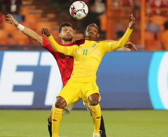 Khama Billiat of Zimbabwe shields ball from Tarek Hamed of Egypt during the 2019 Africa Cup of Nations Finals football match between Egypt and Zimbabwe at the Cairo International Stadium, Cairo, Egypt on 21 June 2019 ©BackpagePix