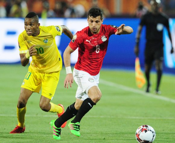 Tarek Hamed of Egypt is challenged by Ovidy Karuru of Zimbabwe during the 2019 Africa Cup of Nations Finals opening game between Egypt and Zimbabwe at Cairo International Stadium, Cairo, Egypt on 21 June 2019 © Ryan Wilkisky/BackpagePix