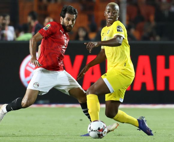 Marwan Mohsin of Egypt challenged by Alec Mudimu of Zimbabwe during the 2019 Africa Cup of Nations Finals match between Egypt and Zimbabwe at Cairo International Stadium, Cairo, Egypt on 21 June 2019 ©Samuel Shivambu/BackpagePix