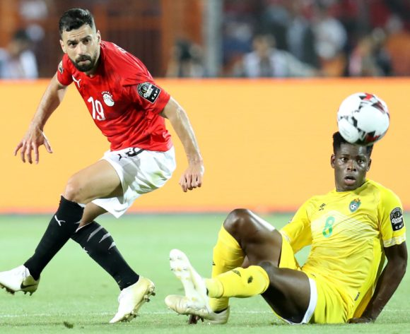 Abdallah El Said of Egypt tackled by Marshall Munetsi of Zimbabwe during the 2019 Africa Cup of Nations Finals match between Egypt and Zimbabwe at Cairo International Stadium, Cairo, Egypt on 21 June 2019 ©Samuel Shivambu/BackpagePix
