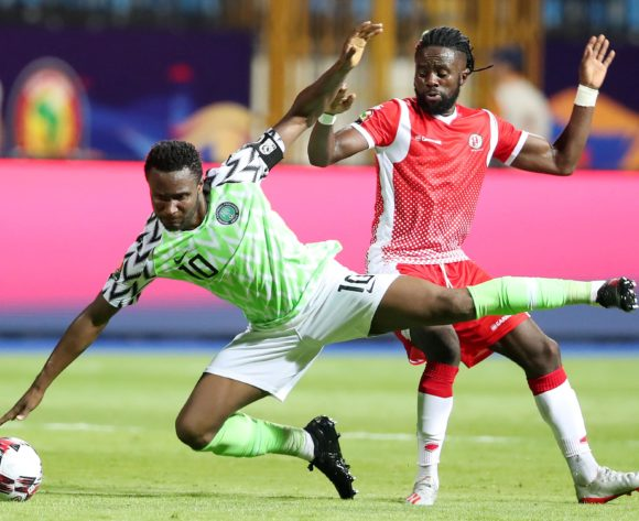 John Obi Mikel of Nigeria fouled by Gael Bigirimana of Burundi during the 2019 Africa Cup of Nations Finals match between Nigeria and Burundi at the Alexandria Stadium, Alexandria on the 22 June 2019 ©Muzi Ntombela/BackpagePix