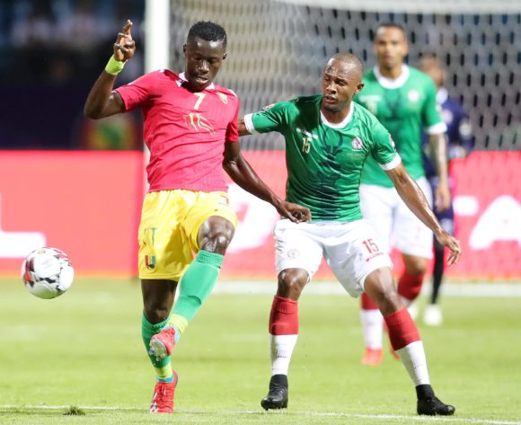 Mohamed Mady Camara of Guinea challenged by Ibrahim Samuel Amada of Madagascar during the 2019 Africa Cup of Nations Finals match between Guinea and Madagascar at the Alexandria Stadium, Alexandria on the 22 June 2019 ©Muzi Ntombela/BackpagePix