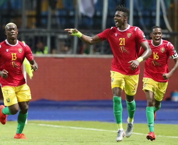 Sory Kaba of Guinea (c) celebrates goal with teammate during the 2019 Africa Cup of Nations Finals match between Guinea and Madagascar at the Alexandria Stadium, Alexandria on the 22 June 2019 ©Muzi Ntombela/BackpagePix