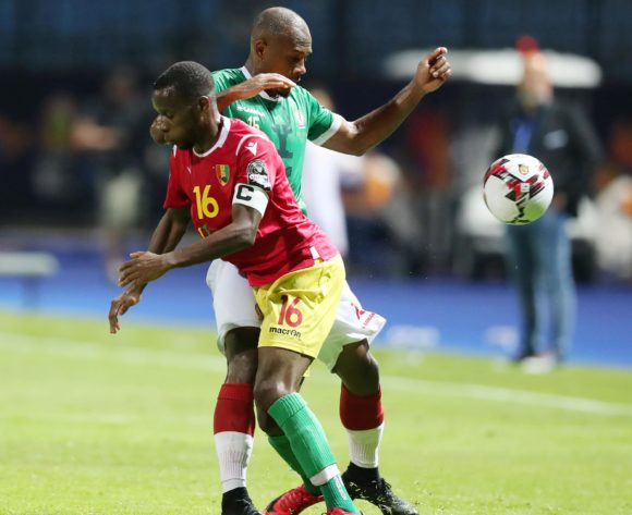 Ibrahim Samuel Amada of Madagascar challenged by Ibrahima Traore of Guinea during the 2019 Africa Cup of Nations Finals match between Guinea and Madagascar at the Alexandria Stadium, Alexandria on the 22 June 2019 ©Muzi Ntombela/BackpagePix