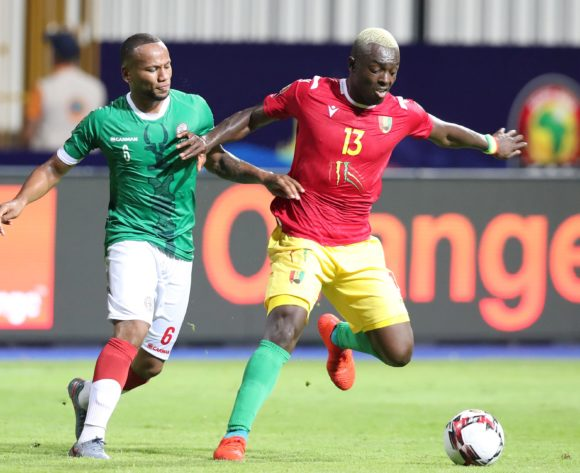 Marco Ilaiharitra of Madagascar challenged by Ibrahima Cisse of Guinea during the 2019 Africa Cup of Nations Finals match between Guinea and Madagascar at the Alexandria Stadium, Alexandria on the 22 June 2019 ©Muzi Ntombela/BackpagePix