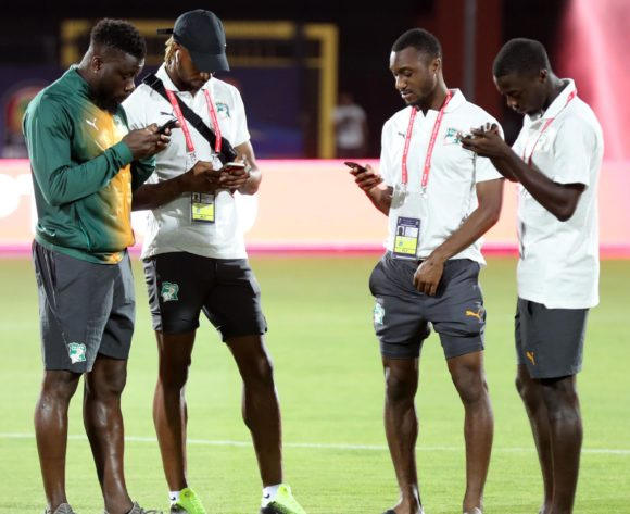 Ivory Coast players on their phones during the 2019 Africa Cup of Nations Finals Ivory Coast at Training at AL- Salaam Stadium, Cairo, Egypt on 22 June 2019 ©Samuel Shivambu/BackpagePix