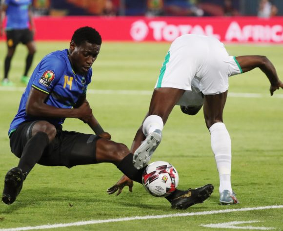 John Bocco of Tanzania tackles Ismaila Sarr of Senegal during the 2019 Africa Cup of Nations Finals football match between Senegal and Tanzania at 30 June Stadium, Ciro, Egypt on 23 June 2019 ©Gavin Barker/BackpagePix