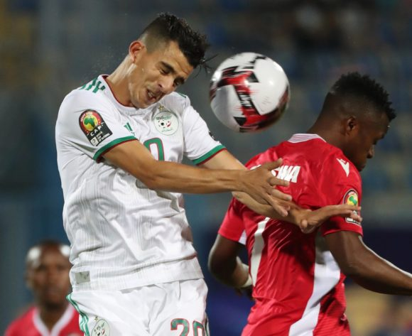 Youcef Atal of Algeria wins header against Masika Ayub of Kenya during the 2019 Africa Cup of Nations Finals football match between Algeria and Kenya at 30 June Stadium, Cairo, Egypt on 23 June 2019 ©Gavin Barker/BackpagePix