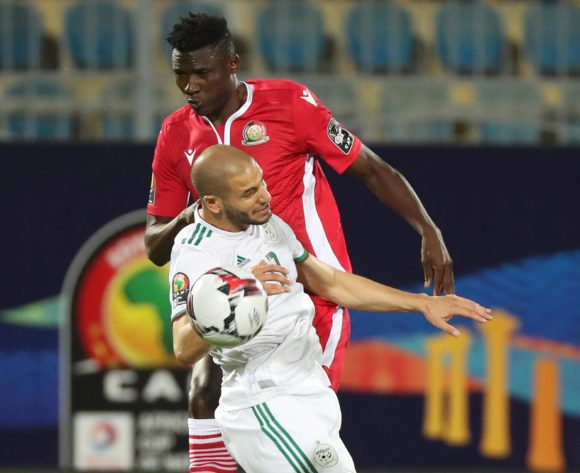 Michael Olunga of Kenya wins header against Adlane Guedioura of Algeria  during the 2019 Africa Cup of Nations Finals football match between Algeria and Kenya at 30 June Stadium, Cairo, Egypt on 23 June 2019 ©Gavin Barker/BackpagePix