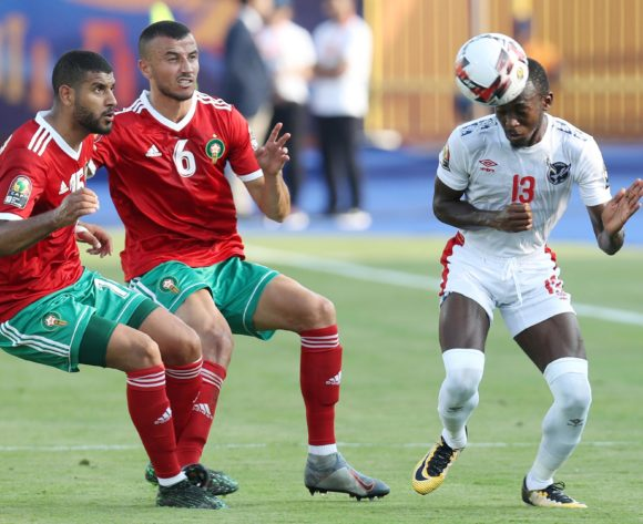 Peter Shalulile (r) of Namibia challenged by Ghanem Saiss (c) and Youssef Ait Bennasser (l) of Morocco during the 2019 Africa Cup of Nations Finals match between Morocco and Namibia at Training at Al-Salaam Stadium, Cairo, Egypt on 23 June 2019 ©Samuel Shivambu/BackpagePix