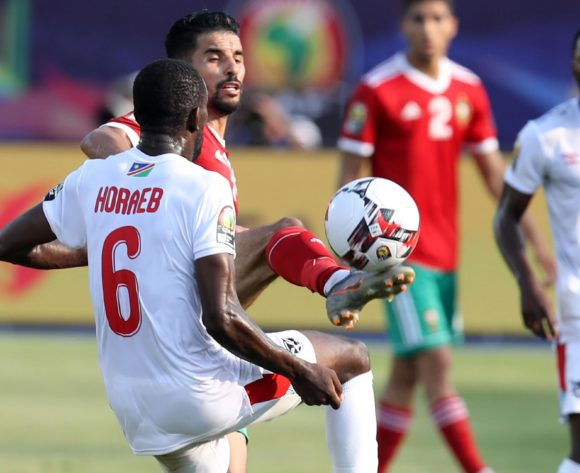 M'bark Boussoufa of Morocco challenged by Larry Horaeb of Namibia during the 2019 Africa Cup of Nations Finals match between Morocco and Namibia at Training at Al-Salaam Stadium, Cairo, Egypt on 23 June 2019 ©Samuel Shivambu/BackpagePix