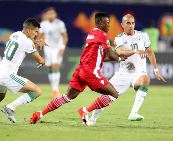 Masika Ayub of Kenya challenged by Youcef Atal and Sofiane Feghouli of Algeria during the 2019 Africa Cup of Nations Finals football match between Algeria and Kenya at 30 June Stadium, Cairo, Egypt on 23 June 2019 ©Samuel Shivambu/BackpagePix
