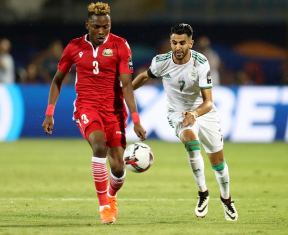 Aboud Omar of Kenya challenged by Riyad Mahrez of Algeria during the 2019 Africa Cup of Nations Finals football match between Algeria and Kenya at 30 June Stadium, Cairo, Egypt on 23 June 2019 ©Samuel Shivambu/BackpagePix