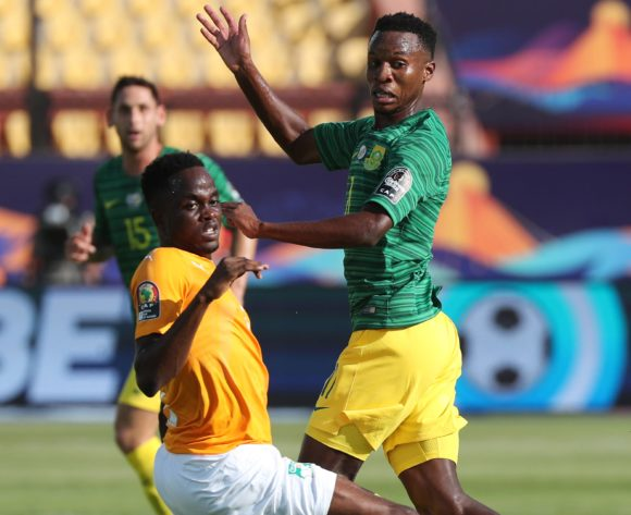Themba Zwane of South Africa challenged by Wonlo Coulibaly of Ivory Coast during the 2019 Africa Cup of Nations Finals football match between Ivory Coast and South Africa at the Al Salaam Stadium, Cairo, Egypt on 24 June 2019 ©Gavin Barker/BackpagePix
