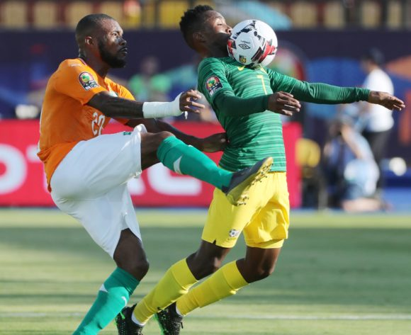 Lebohang Maboe of South Africa challenged by Geoffroy Die Serey of Ivory Coast during the 2019 Africa Cup of Nations Finals football match between Ivory Coast and South Africa at the Al Salaam Stadium, Cairo, Egypt on 24 June 2019 ©Gavin Barker/BackpagePix