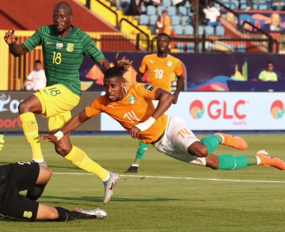 Jonathan Kodjia of Ivory Coast scores goal, challenged by Sifiso Hlanti of South Africa during the 2019 Africa Cup of Nations Finals football match between Ivory Coast and South Africa at the Al Salaam Stadium, Cairo, Egypt on 24 June 2019 ©Gavin Barker/BackpagePix