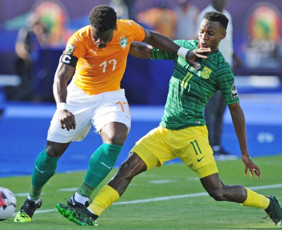 Serge Aurier of Ivory Coast is tackled by Themba Zwane of South Africa during the 2019 Africa Cup of Nations Finals game between Ivory Coast and South Africa at Al Salam Stadium in Cairo, Egypt on 24 June 2019 © Ryan Wilkisky/BackpagePix
