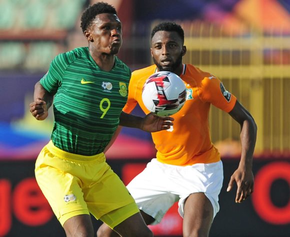 Lebo Mothiba of South Africa controls the ball ahead of Wilfried Kanon of Ivory Coast during the 2019 Africa Cup of Nations Finals game between Ivory Coast and South Africa at Al Salam Stadium in Cairo, Egypt on 24 June 2019 © Ryan Wilkisky/BackpagePix