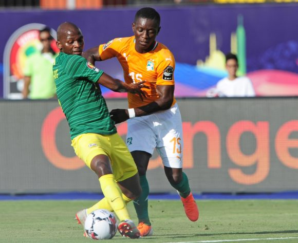 Thamsanqa Mkhize of South Africa is challenged by Max Gradel of Ivory Coast during the 2019 Africa Cup of Nations Finals game between Ivory Coast and South Africa at Al Salam Stadium in Cairo, Egypt on 24 June 2019 © Ryan Wilkisky/BackpagePix