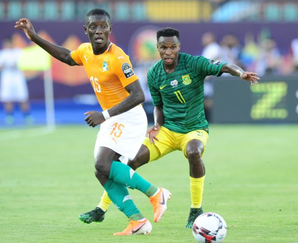 Max Gradel of Ivory Coast gets his pass away as he is challenged by Themba Zwane of South Africa during the 2019 Africa Cup of Nations Finals game between Ivory Coast and South Africa at Al Salam Stadium in Cairo, Egypt on 24 June 2019 © Ryan Wilkisky/BackpagePix
