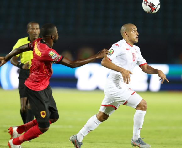 Wahbi Khazri of Tunisia challenged by Bastos Quissanga of Angola during the 2019 Africa Cup of Nations Finals football match between Tunisia and Angola at Suez Army Stadium, Suez, Egypt on 24 June 2019 ©Samuel Shivambu/BackpagePix