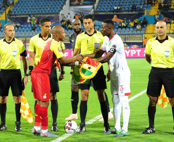 Ghana captain Andre Ayew and Benin captain Abdou Adenon shake hands before the 2019 Africa Cup of Nations Finals game between Ghana and Benin at Ismailia Stadium in Ismailia, Egypt on 25 June 2019 © Ryan Wilkisky/BackpagePix