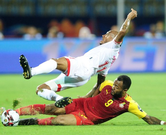 Emmanuelle Imorou of Benin is tackled by Jordan Ayew of Ghana during the 2019 Africa Cup of Nations Finals game between Ghana and Benin at Ismailia Stadium in Ismailia, Egypt on 25 June 2019 © Ryan Wilkisky/BackpagePix