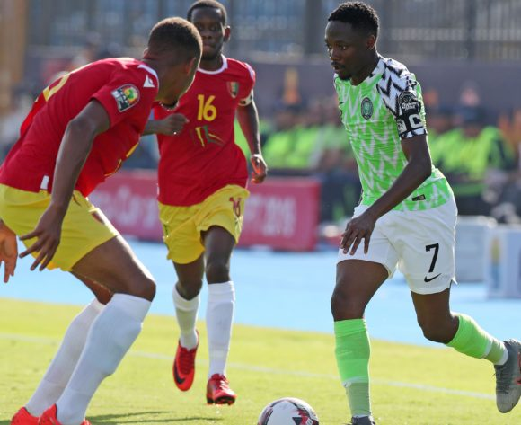 Ahmed Musa of Nigeria challenged by Dyrestam Mikael Bertil of Guinea during the 2019 Africa Cup of Nations match between Nigeria and Guinea at the Alexandria Stadium, Alexandria on the 26 June 2019 ©Muzi Ntombela/BackpagePix