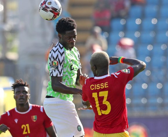 Temitayo Olufisayo Aina of Nigeria challenged by Ibrahima Cisse of Guinea during the 2019 Africa Cup of Nations match between Nigeria and Guinea at the Alexandria Stadium, Alexandria on the 26 June 2019 ©Muzi Ntombela/BackpagePix