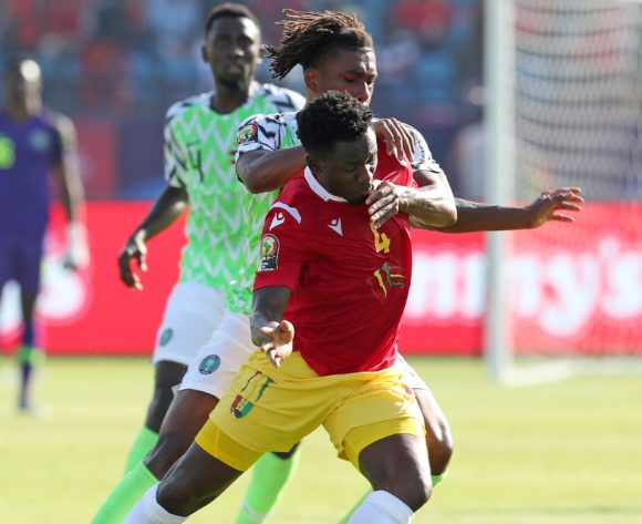 Alexander Iwobi of Nigeria challenges Amadou Diawara of Guinea during the 2019 Africa Cup of Nations match between Nigeria and Guinea at the Alexandria Stadium, Alexandria on the 26 June 2019 ©Muzi Ntombela/BackpagePix