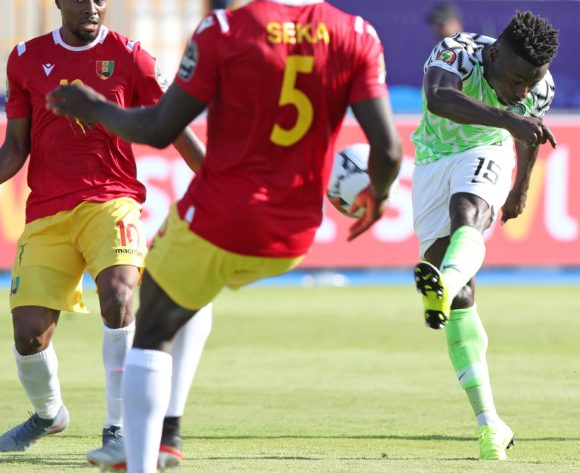 Moses Simon of Nigeria takes a shot at goal while challenged by Ernest Seka Boka of Guinea (5) during the 2019 Africa Cup of Nations match between Nigeria and Guinea at the Alexandria Stadium, Alexandria on the 26 June 2019 ©Muzi Ntombela/BackpagePix