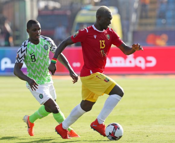 Ibrahima Cisse of Guinea challenged by Odion Jude Ighalo of Nigeria during the 2019 Africa Cup of Nations match between Nigeria and Guinea at the Alexandria Stadium, Alexandria on the 26 June 2019 ©Muzi Ntombela/BackpagePix