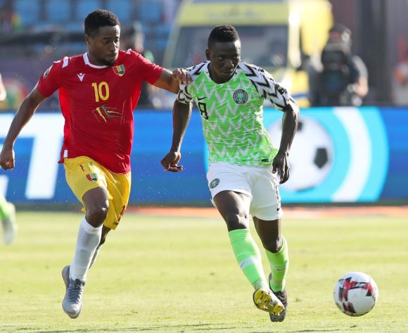 Peter Etebo of Nigeria challenged by Francois Kamano of Guinea during the 2019 Africa Cup of Nations match between Nigeria and Guinea at the Alexandria Stadium, Alexandria on the 26 June 2019 ©Muzi Ntombela/BackpagePix
