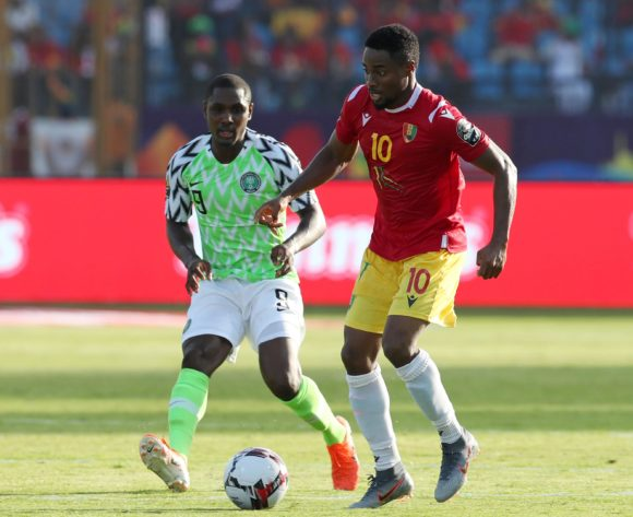 Francois Kamano of Guinea challenged by Odion Jude Ighalo of Nigeria during the 2019 Africa Cup of Nations match between Nigeria and Guinea at the Alexandria Stadium, Alexandria on the 26 June 2019 ©Muzi Ntombela/BackpagePix