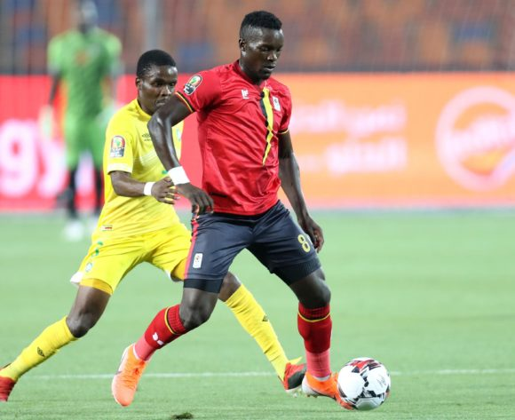 Khalid Aucho of Uganda challenged by Danny Phiri of Zimbabwe during the 2019 Africa Cup of Nations Finals match between Uganda and Zimbabwe at Cairo International Stadium, Cairo, Egypt on 26 June 2019 ©Samuel Shivambu/BackpagePix