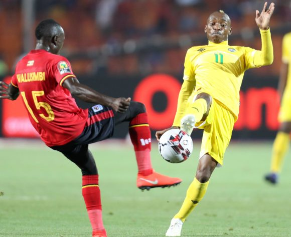 Teenage Hadebe of Zimbabwe challenged by Godfrey Walusimbi of Uganda during the 2019 Africa Cup of Nations Finals match between Uganda and Zimbabwe at Cairo International Stadium, Cairo, Egypt on 26 June 2019 ©Samuel Shivambu/BackpagePix