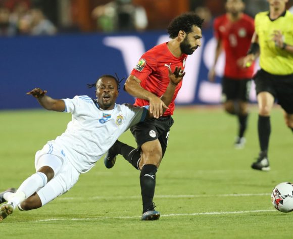 Tresor Mputu of DR Congo challenged by Mohamed Salah of Egypt  during the 2019 Africa Cup of Nations Finals match between Egypt and Dr Congo at Cairo International Stadium, Cairo, Egypt on 26 June 2019 ©Samuel Shivambu/BackpagePix