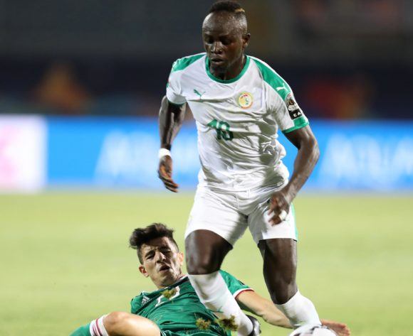 Sadio Mane of Senegal tackled by Youcef Atal of Algeria during the 2019 Africa Cup of Nations Finals match between Senegal and Algeria at 30 June Stadium, Cairo, Egypt on 27 June 2019 ©Samuel Shivambu/BackpagePix