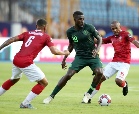 John Ogu of Nigeria challenged by Marco Ilaiharitra (l) and Ibrahim Samuel Amada of Madagascar during the 2019 Africa Cup of Nations match between Madagascar and Nigeria at the Alexandria Stadium, Alexandria on the 30 June 2019 ©Muzi Ntombela/BackpagePix