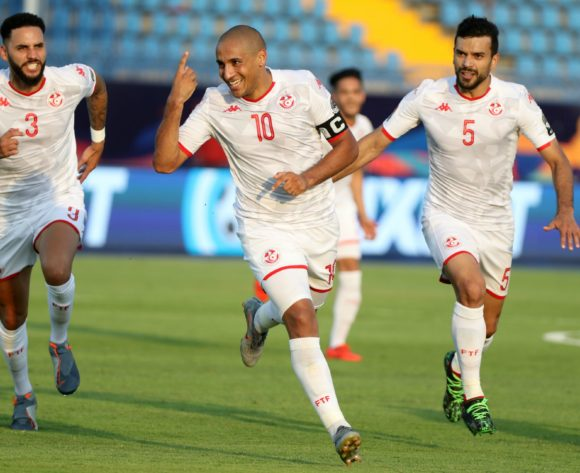 Wahbi Khazri celebrates goal with Dylan Bronn and Oussama Hadadi of Tunisia during the 2019 Africa Cup of Nations Finals match between Tunisia and Mali at Suez Stadium, Suez, Egypt on 28 June 2019 ©Samuel Shivambu/BackpagePix