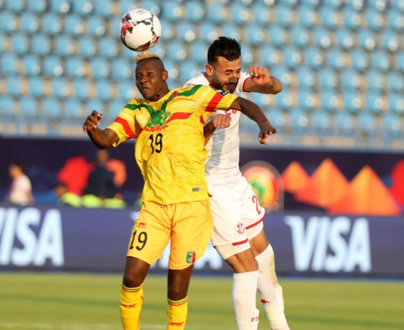 Moussa Djenepo of Mali challenged by Ghaylen Chaaleli of Tunisia during the 2019 Africa Cup of Nations Finals match between Tunisia and Mali at Suez Stadium, Suez, Egypt on 28 June 2019 ©Samuel Shivambu/BackpagePix