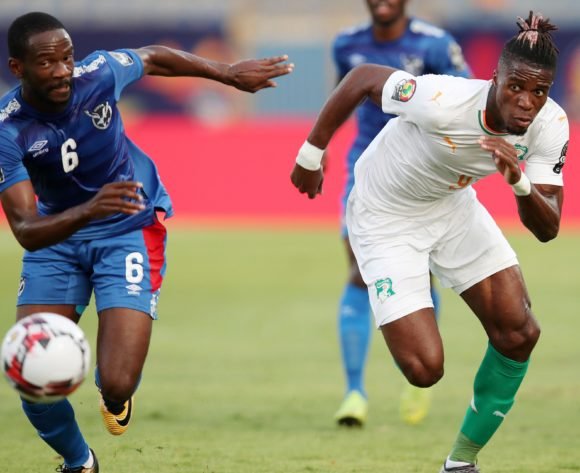 Wilfried Zaha of Ivory Coast challenged by Larry Horaeb of Namibia during the 2019 Africa Cup of Nations match between Namibia and Ivory Coast at the 30 June Stadium, Cairo on the 01 July 2019 ©Muzi Ntombela/BackpagePix