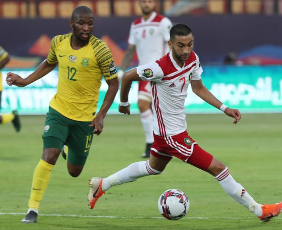 Hakim Ziyach of Morocco challenged by Kamohelo Mokotjo of South Africa during the 2019 Africa Cup of Nations Finals football match between South Africa and Morocco at the Al Salam Stadium, Cairo, Egypt on 01 July 2019 ©Gavin Barker/BackpagePix