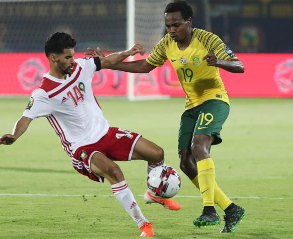Percy Tau of South Africa challenged by M'bark Boussoufa of Morocco  during the 2019 Africa Cup of Nations Finals football match between South Africa and Morocco at the Al Salam Stadium, Cairo, Egypt on 01 July 2019 ©Gavin Barker/BackpagePix
