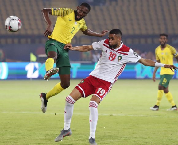 Buhle Mkhwanazi of South Africa challenged by Youssef En-Nesyri of Morocco  during the 2019 Africa Cup of Nations Finals football match between South Africa and Morocco at the Al Salam Stadium, Cairo, Egypt on 01 July 2019 ©Gavin Barker/BackpagePix