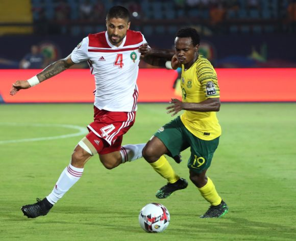 Manuel Marouan Da Costa Trinidad of Morocco challenged by Percy Tau of South Africa during the 2019 Africa Cup of Nations Finals football match between South Africa and Morocco at the Al Salam Stadium, Cairo, Egypt on 01 July 2019 ©Gavin Barker/BackpagePix